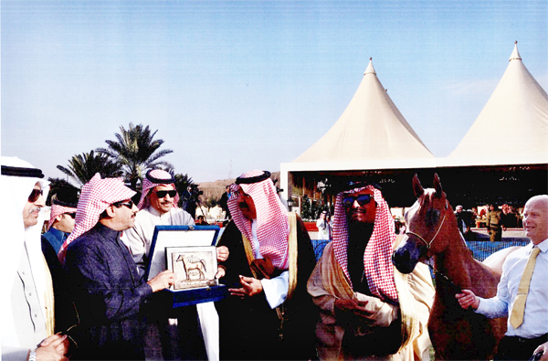 L-R: Dr. Fahad Bin Abdul Rahman Balghinaim, Minister of Agriculture;  Mohammed bin Abdallah Bin Mohammed Al Subaie, Owner; Khalid Bin Abdallah Al Thoum, Head of Registration & Shows at KAAHC; HRH Prince Faisal Bin Abdallah Bin Mohammed Al Saud; Mr. Sami Bin Suleiman Al Nohait, WAHO Executive Committee and Supervisor General of KAAHC;  Hawaizin Al Muawd, 2013 WAHO Trophy Winner, Saudi Arabia; Ryan Jones (Trainer and handler).