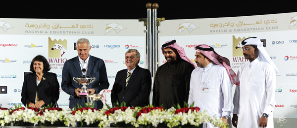 Peter Pond and his wife Jenny presenting the Jay Stream Cup to the winning connections from Umm Qarn Farm