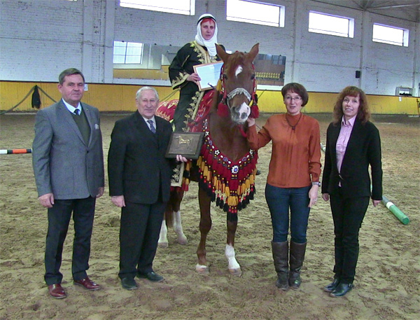 WAHO Trophy Presentation: L-R:  Wladyslaw Guziuk (Judge from Poland), Stasys Svetlauskas (President, Lithuanian Horse Breeders Association), Olga Sivec (Owner) on Startas, Rūta Šveistienė (Lithuanian Horse Breeders Association), Nemira Stašienė (Lithuanian Horse Breeders Association).